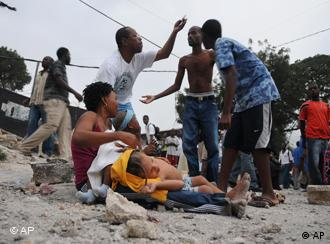 People gather in the street after an earthquake in Port-au-Prince, Haiti