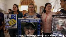 Mothers and relatives of jailed anti-government demonstrators holds signs with images of their imprisoned sons and family, at the San Miguel Arcangel Church in Masaya, Nicaragua, Thursday, Nov. 14, 2019. The group have started a hunger strike to demand the freedom of their relatives, jailed for protesting against the government of President Daniel Ortega. (AP Photo/Alfredo Zuniga) |