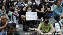 Protesters gather during a rally in Hong Kong, Friday, Nov. 15, 2019. Protesters who had barricaded themselves in a Hong Kong university this week began to leave Friday after partially clearing a road they had blocked and demanding that the government commit to going ahead with local elections on Nov. 24. (AP Photo/Achmad Ibrahim)  