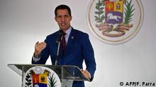 Venezuelan opposition leader and self-proclaimed acting president Juan Guaido speaks during a press conference in Caracas, on November 15, 2019. (Photo by Federico PARRA / AFP)