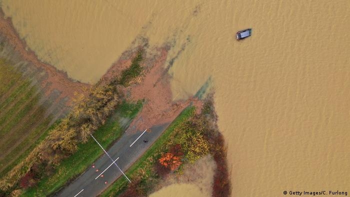 A car is seen part submerged in floodwater, at Bardney, near Lincoln, after the Barlings Eau broke its banks on November 15, 2019 (Getty Images/C. Furlong)