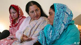Sakina, right, and her sister Shahina, left, acid attack victims give a news conference with the help of women rights activist Shahnaz Bukhari in Islamabad (Photo: AP Photo/Tariq Aziz)