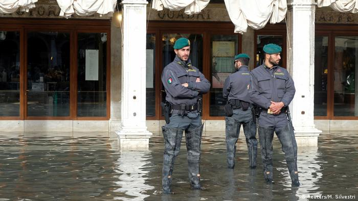 Police officers patrol St Mark's Square