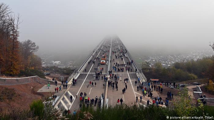 Pedestrians cross the High Mosel Bridge ahead of its opening