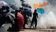 A protester's umbrella catches on fire during clashes with police outside Hong Kong Polytechnic University (PolyU) in Hong Kong, China November 17, 2019. REUTERS/Adnan Abidi TPX IMAGES OF THE DAY