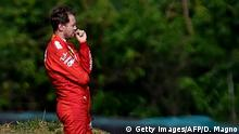 Ferrari's German driver Sebastian Vettel reacts while a crane lifts his car during the F1 Brazil Grand Prix, at the Interlagos racetrack in Sao Paulo, Brazil on November 17, 2019. (Photo by Douglas Magno / AFP) (Photo by DOUGLAS MAGNO/AFP via Getty Images)