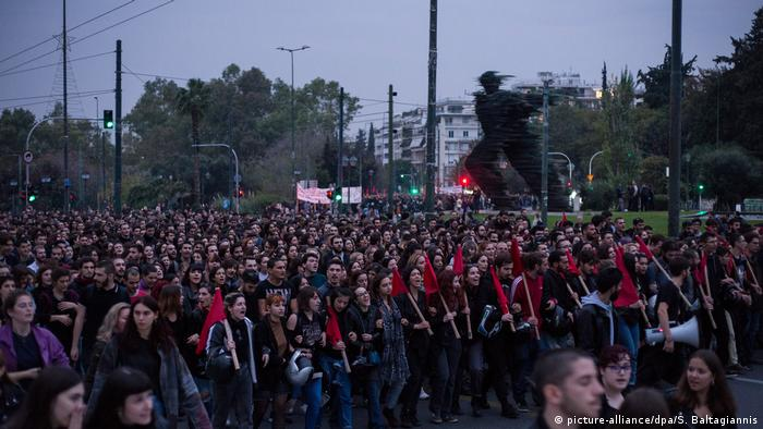 Tens of thousands of people march towards the US embassy in Athens