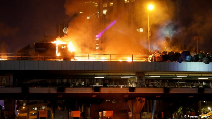 Protesters clash with police at the entrance to the Cross Harbor Tunnel