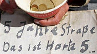 A begging pot with a note asking for donations
