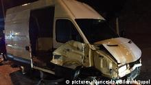 A van sustained significant damage after smashing into a border to reach Spain's Ceuta with 50 migrants on board (picture-alliance/dpa/Bildfunk/Jupol)