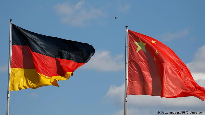 German and Chinese flags wave in the wind in Berlin, Germany (Getty Images/AFP/O. Andersen)