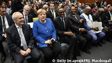 (LtoR) Chairman of the Sub-Saharan Africa Initiative of German Business (SAFRI), Heinz-Walter Grosse, German Chancellor Angela Merkel, Rwanda's President Paul Kagame and Ivory Coast's President Alassane Ouattara arrive to attend the G20 Investment Summit - German Business and the CwA Countries 2019 on the sidelines of a Compact with Africa (CwA) conference in Berlin on November 19, 2019. (Photo by John MACDOUGALL / POOL / AFP) (Photo by JOHN MACDOUGALL/POOL/AFP via Getty Images)