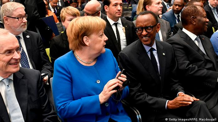 Angela Merkel and Paul Kagame (Getty Images/AFP/J. Macdougall)