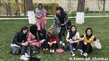 A group of girls pose for a picture in Chihilsitoon Garden, which was restored after it was damaged during four decades of war in Kabul, Afghanistan. November 6, 2019. Thomson Reuters Foundation/Rina Chandran