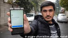 November 18, 2019, Tehran, IRAN: An Iranian man shows his phone while unable to load an international website as internet service is reportedly disrupted in Tehran, Iran. Internet access has been limited in the country amid protests over increasing fuel price in Iran. (Credit Image: © Rouzbeh Fouladi/ZUMA Wire |