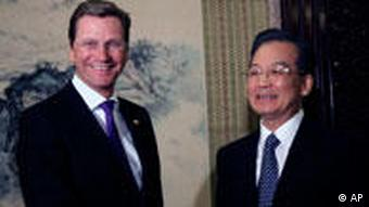 Chinese Premier Wen Jiabao, right, shakes hand with Germany's Vice Chancellor and Foreign Minister Guido Westerwelle before a meeting at the Zhongnanhai compound in Beijing, China, Friday, Jan. 15, 2010. (AP Photo/Ng Han Guan, Pool3