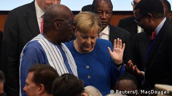 Deutschland Berlin | Konferenz Compact with Africa | Angela Merkel, Bundeskanzlerin | mit Roch Marc Christian Kabore, Burkina Faso (Reuters/J. MacDougall)