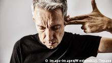 Portrait of mature man making shooting gesture with his hand against his temple model released Symbolfoto PUBLICATIONxINxGERxSUIxAUTxHUNxONLY JATF01116