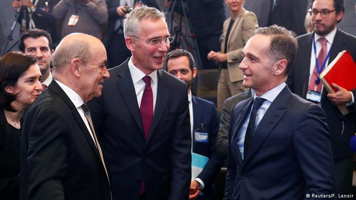 NATO Secretary General Jens Stoltenberg talks to French Foreign Minister Jean-Yves Le Drian and German Foreign Minister Heiko Maas