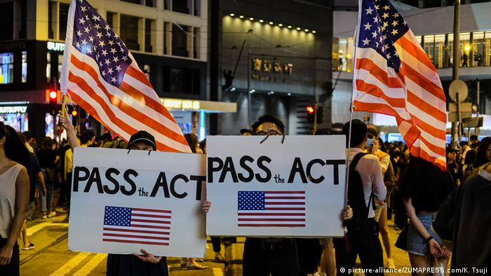 Protesters with Pass the Act signs