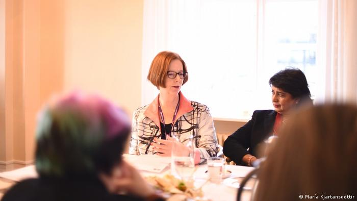 Australia's former prime minister Julia Gillard at a table with other femal leaders