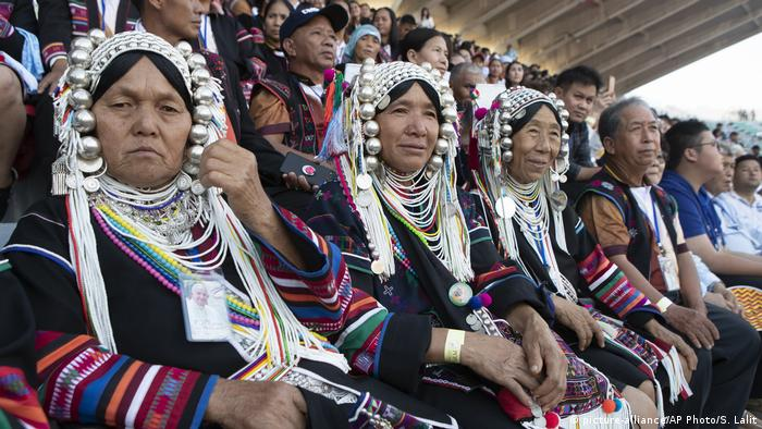 Catholics from tribal areas wait for Pope Francis before a Holy Mass at National Stadium in Bangkok, Thailand