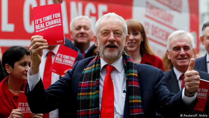 Jeremy Corbyn holds his party's general election manifesto