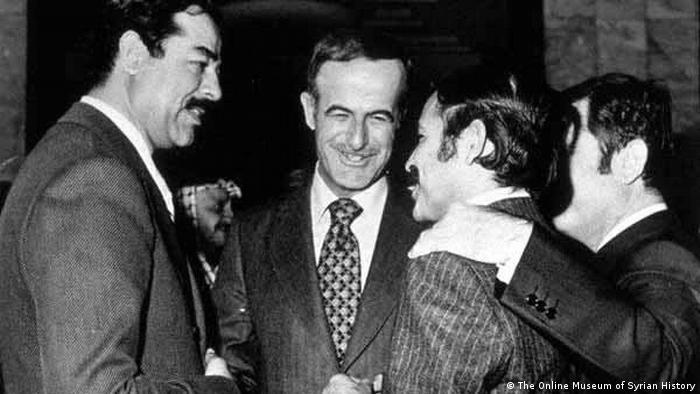 الرئيس السوري السابق حافظ الأسد والرئيس العراقي الأسبق صدام حسين