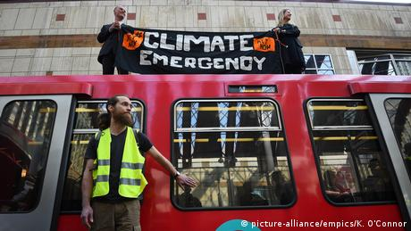 Extinction Rebellion protesters glue themselves to a train in London