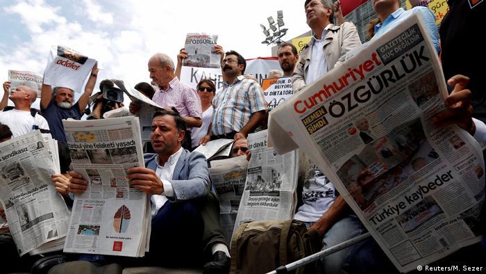 Turkish freedom activists read Cumhuriyet newspaper