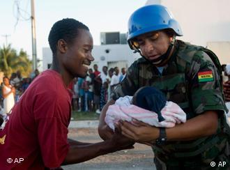 A UN soldier helping a Haitian in Port-au-Prince