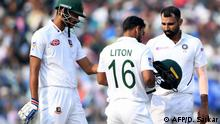 22.11.2019 India's bowler Mohammed Shami (R) speaks with Bangladesh's batsman Liton Das (C) after he was hit by his ball delivery during the first day of the second Test cricket match of a two-match series between India and Bangladesh at The Eden Gardens cricket stadium in Kolkata on November 22, 2019. (Photo by Dibyangshu SARKAR / AFP) / IMAGE RESTRICTED TO EDITORIAL USE - STRICTLY NO COMMERCIAL USE