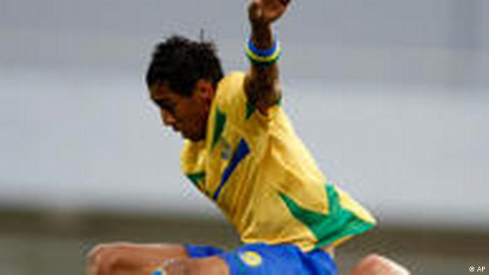 Gabon's Pierre Emerick Aubameyang, top, collides with Tunisia's Khaled Korbi in their African Cup of Nations Group D match at Tundavala Stadium in Lubango, Angola, Sunday, Jan. 17, 2010. (AP Photo/Rebecca Blackwell)