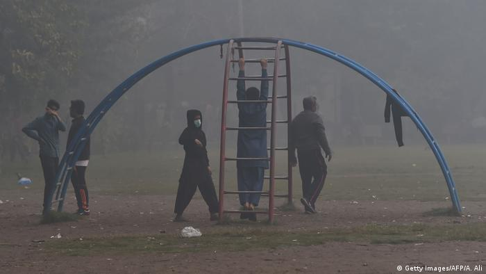 Kids in smog at a playground