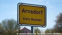 Ortseingangsschild von Arnsdorf (Sachsen)