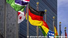 Flags, including that of Germany, in front of the UN headquarters in New York