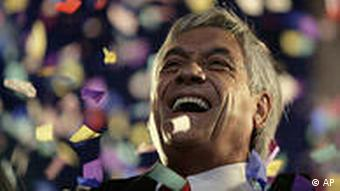 Chile's President-elect Sebastian Pinera laughs during an event to celebrate his victory in the runoff presidential election in Santiago, Sunday, Jan. 17, 2010. Billionaire Sebastian Pinera won the election, ending two decades of center-left rule. (AP Photo/Jorge Saenz)