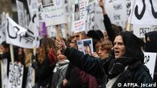 People take part in a protest to condemn violence against women, on November 23, 2019, in Paris. (Photo by Alain JOCARD / AFP)
