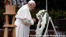 Pope Francis offers prayer after laying a wreath at the Atomic Bomb Hypocenter Park, Sunday, Nov. 24, 2019, in Nagasaki, Japan. (AP Photo/Gregorio Borgia)