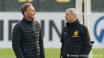 Hans-Joachim Watzke (left) with Dortmund coach Lucien Favre