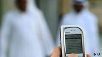 A Saudi man reads a message at his mobile that instructs Muslims to boycott Danish products, in Riyadh, Saudi Arabia Friday Jan. 27, 2006. Denmark's main industry organization, fearing a loss of business in the Muslim world, sought to distance itself Friday from a newspaper that published contentious drawings of Islam's Prophet Muhammad. (AP Photo/Khalid Mahmoud)