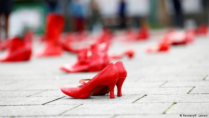 Red shoes on pavement (Reuters/F. Lenoir)