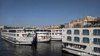Nile cruise ships moored close to eachother at a pier in Aswan