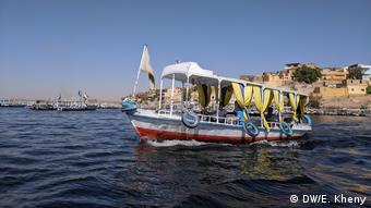 small colorful boat on the Nile river