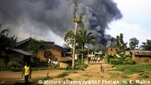 Smoke from the United Nations compound rises in Beni, Democratic Republic of Congo, Monday, Nov. 25, 2019. Angry residents of this eastern Congo city burned the town hall and stormed the UN peacekeeping mission, known as MONUSCO, after Allied Democratic Forces rebels killed eight people and kidnapped nine overnight. (AP Photo/Al-hadji Kudra Maliro) |