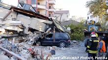 Firefighters stand next to a damaged building after a magnitude 6.4 earthquake in Durres, western Albania, Tuesday, Nov. 26, 2019. A strong earthquake has shaken Albania, killing at least four people, injuring 150 and collapsing buildings. (AP Photo/Hektor Pustina) |