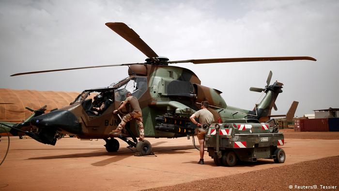 French troops repair a helicopter in Mali
