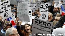 People hold up placards as they gather for a demonstration organised by the Campaign Against Anti-Semitism outside the head office of the British opposition Labour Party in central London on April 8, 2018. Labour leader Jeremy Corbyn has been under increasing pressure to address multiple allegations of anti-Semitism within the party, which saw protesters gather outside the party's head office in London after Jewish campaigners demonstrated outside parliament two weeks ago. / AFP PHOTO / Tolga AKMEN (Photo credit should read TOLGA AKMEN/AFP via Getty Images)