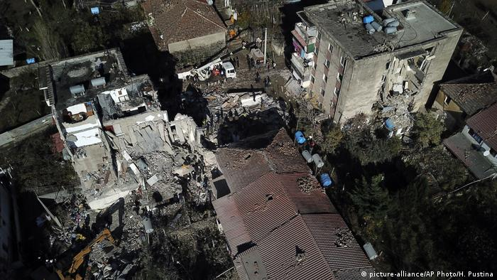 Aerial shot of several partially collapsed buildings