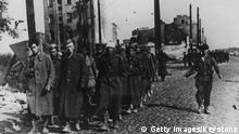 1st October 1944: The end of Warsaw's uprising sees a group of city defenders marched off to prison camps by their German captors. (Photo by Keystone/Getty Images)